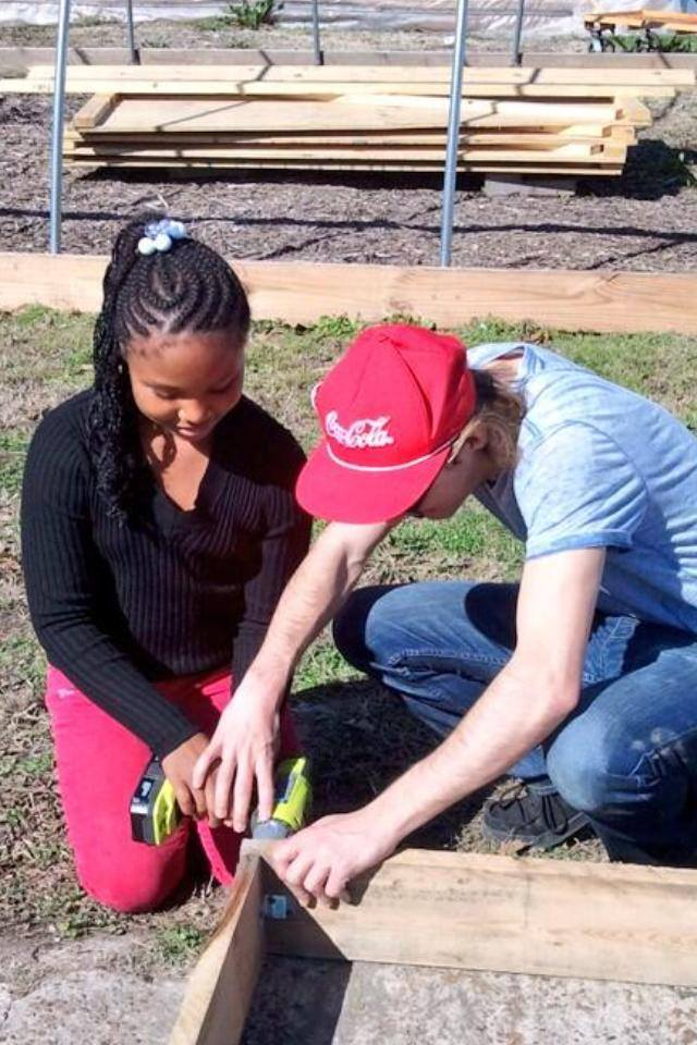 Students in SOC 451 worked at Mississippians Engaging in Greener Agriculture in Shelby, MS to build planter boxes for a teaching garden.